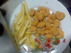 Crumbed Prawns, chips & salad in Mumbai