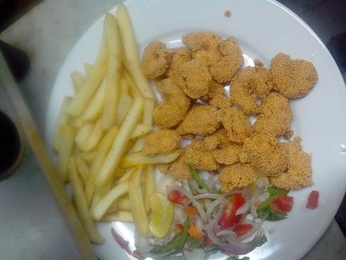 Crumbed Prawns, chips & salad in Mumbai
